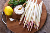Peeled asparagus and sauce