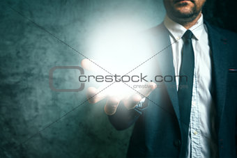 Business vison concept with businessman holding light in hand