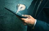 Unrecognizable businessman using digital tablet finger pressing