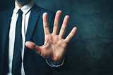 Businessman with long fingers