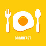 Fried eggs, spoon and fork - breakfast