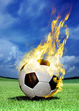 fiery soccer ball on grass