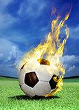 fiery soccer ball on grass