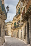 Street with old houses in the historical center of Lecce