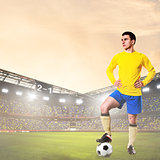 soccer or football player on stadium