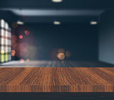 3D wooden table looking to a defocussed empty room with vintage