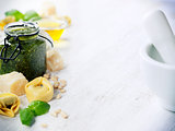Homemade raw Italian tortellini with pesto
