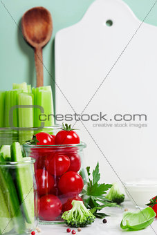 Assorted fresh vegetables with dip and White ceramic serving boa