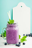 Blueberry smoothie and White ceramic serving board