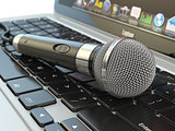 Microphone on the laptop keyboard. Digital audio  music software