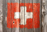 swiss colors on old wooden wound