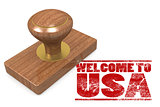 Red rubber stamp with welcome to USA