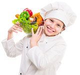 little girl-cook with bowl of vegetables on shoulder