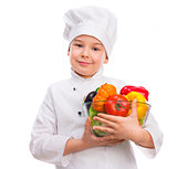 funny little boy-cook holding bowl with vegetables in hands