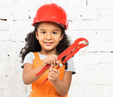 smiling little girl-worker with pliers in hands