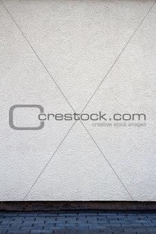 Modern white plaster street wall