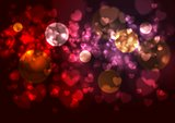 Purple and red background with blurred hearts and bokeh effects