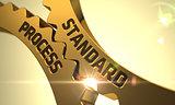 Golden Metallic Cogwheels with Standard Process Concept.