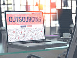 Outsourcing Concept on Laptop Screen.