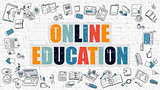 Online Education on White Brick Wall.