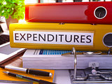 Expenditures on Yellow Ring Binder. Blurred, Toned Image.