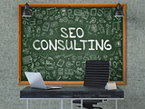 SEO Consulting - Hand Drawn on Green Chalkboard.