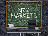 New Markets on Chalkboard in the Office.