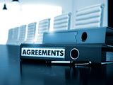 Agreements on Binder. Toned Image.