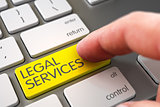 Hand Touching Legal Services Key.