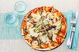 Healthy vegetables and mushrooms vegetarian pizza