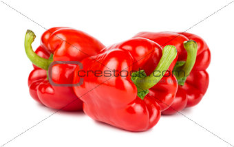 Three red ripe sweet peppers
