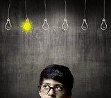 Thinking Half Head Of Genius Little Boy Wearing Glasses