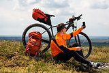 Sportive Man Stops Cycling and Has a Rest on Valley