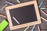 Blackboard sponge and chalks