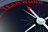 Black compass with teamwork word on it