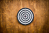 Empty dartboard with wooden background