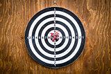Five darts in bullseye, dartboard