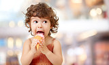 Kid eating ice cream. Funy curly child with icecream.