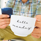 young man with a cup with the text hello monday