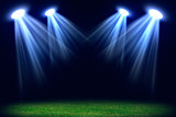 Grass field lit with bright spotlights