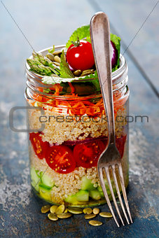 Cucumber, quinoa, tomato, onion, carrot and mint salad in a jar