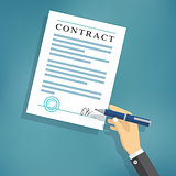 Hand signing contract on white paper.