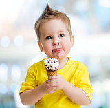 Funny kid eating icecream on blurred background