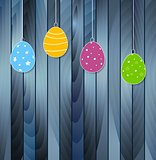 Flat Easter eggs on blue wooden texture background