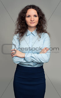 smiling business woman, isolated on gray background