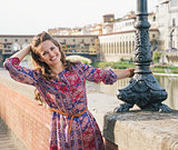 Portrait of happy woman on the embankment near Ponte Vecchio