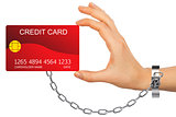 Closeup of red credit card holded by chained hand