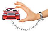 Red car in chained womens hand