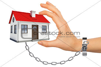 Chained hand holding house