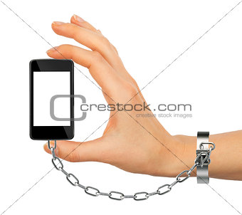 Chained female hand holding phone